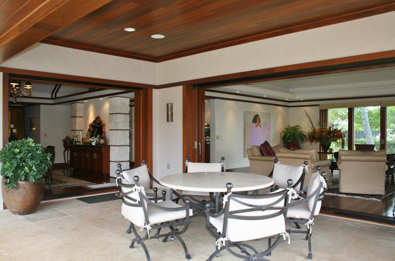 Dining and living rooms open to covered lanai.